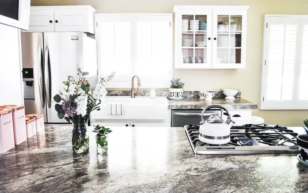 bright remodeled kitchen gray white formica countertops