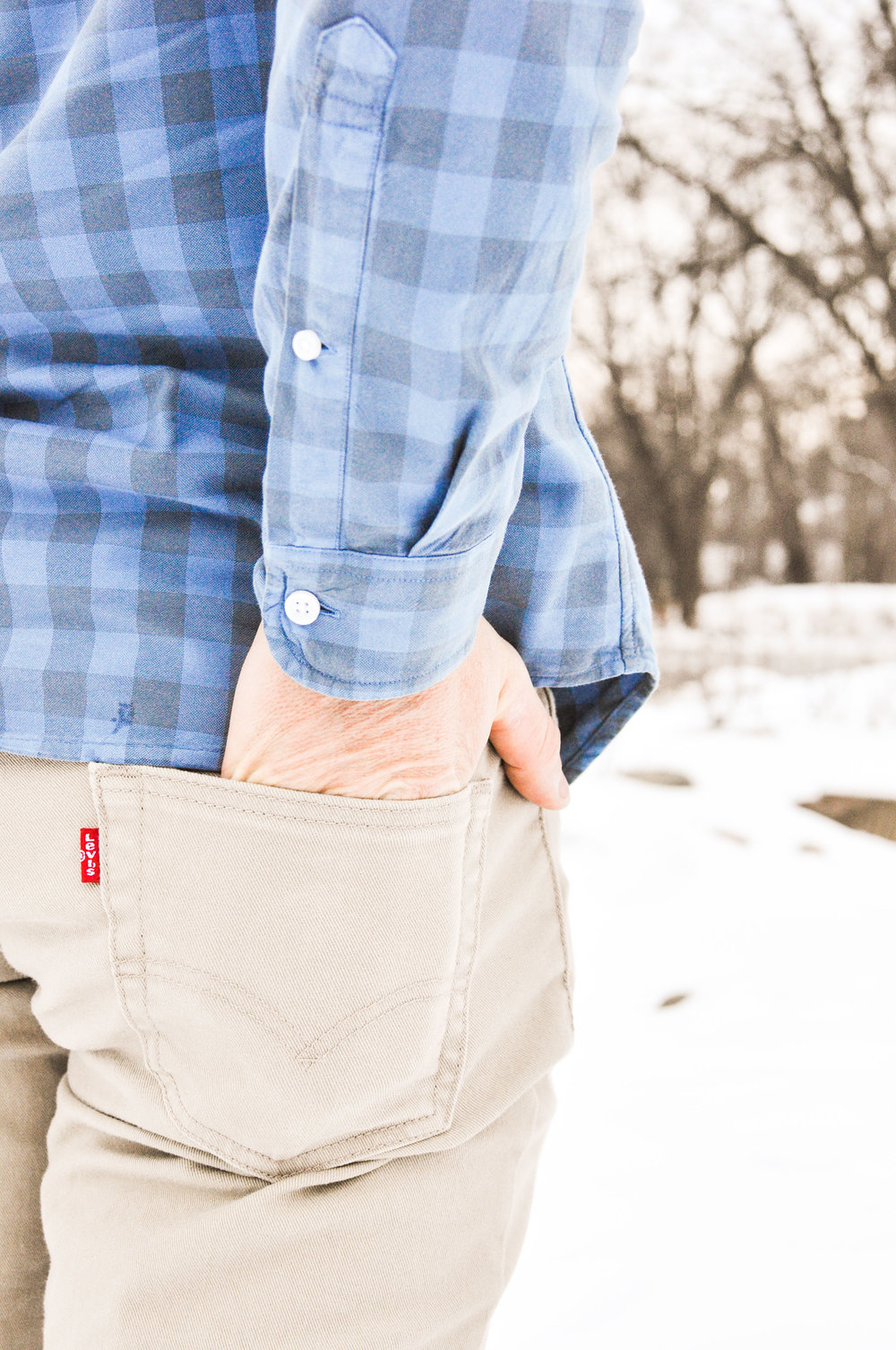 Man with hand in back pocket