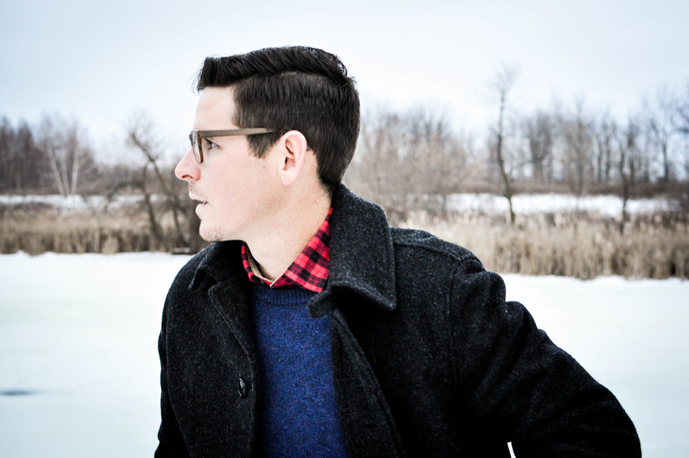 Man with glasses profile shot in winter