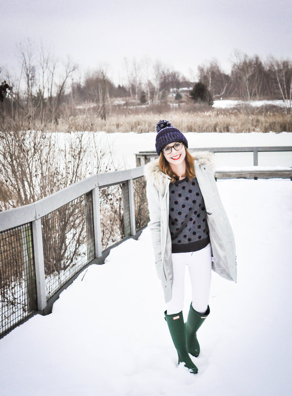 Woman wearing rubber boots in the snow
