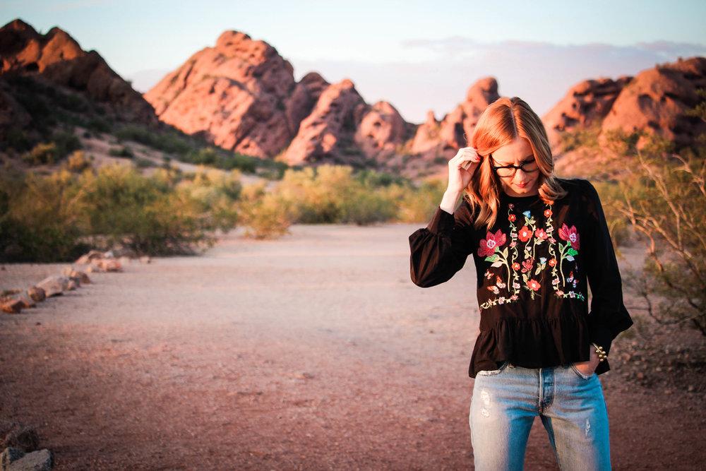 woman in jeans in desert