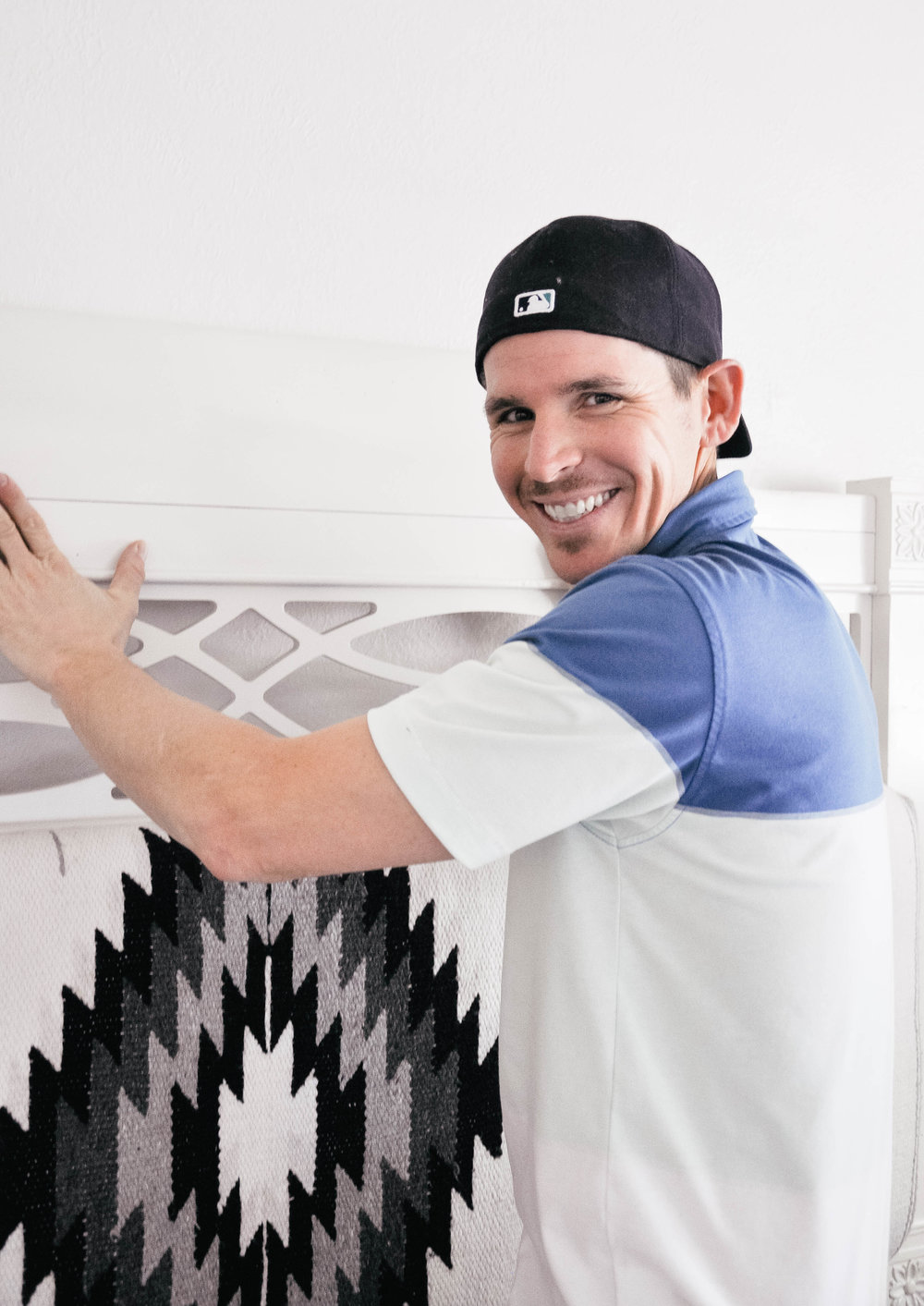 man doing DIY upholstered headboard project