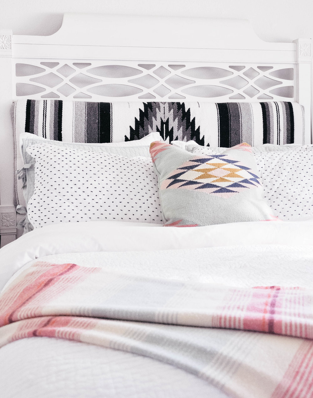 bed with diy upholstered mexican blanket headboard