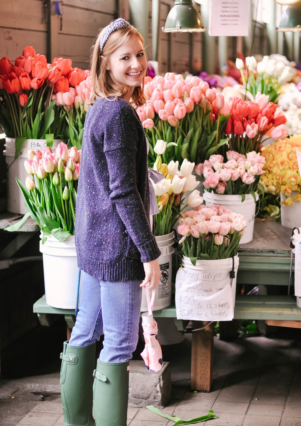 Woman smiling in front of colorful tulips