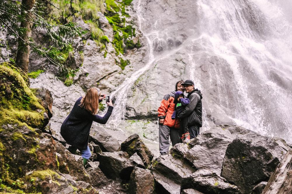 Couple hiking near waterfall in Washington