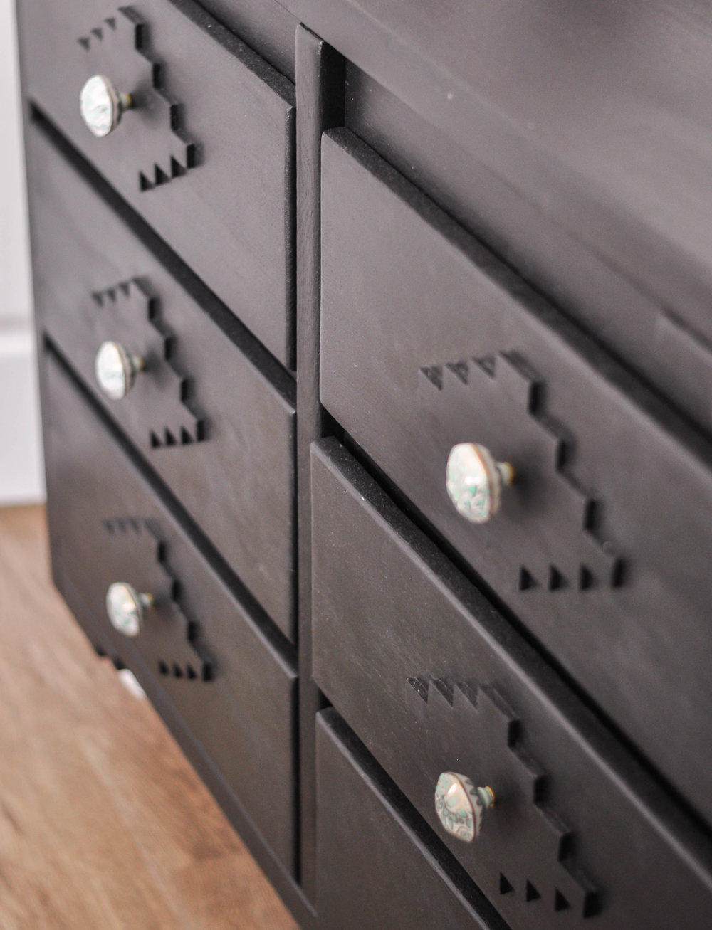 DIY dark wood dresser knobs closeup