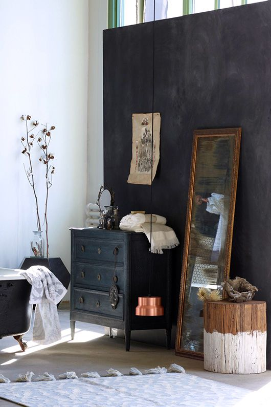 black dresser in bedroom with mirror
