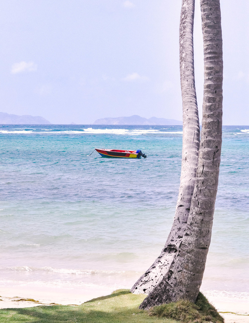 Colorful boat in Caribbean water