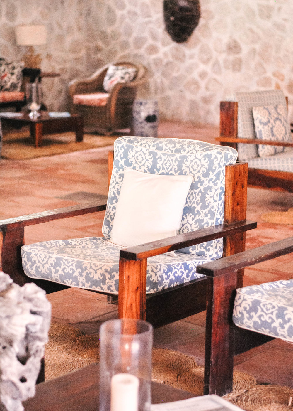 Wooden chair with blue and white cushions
