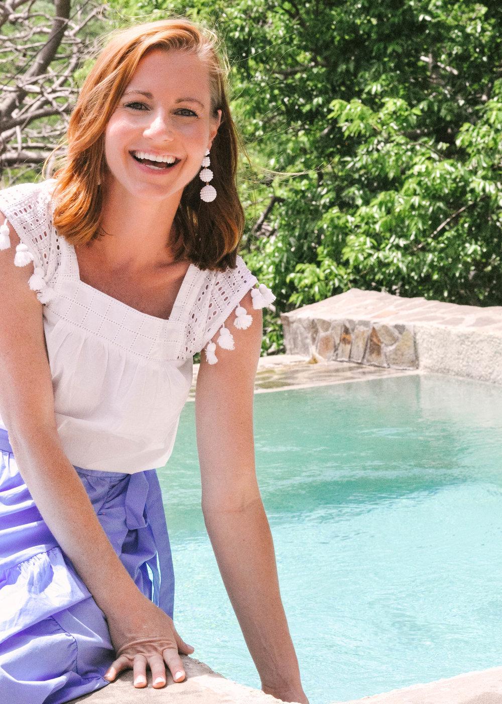 Woman smiling next to pool