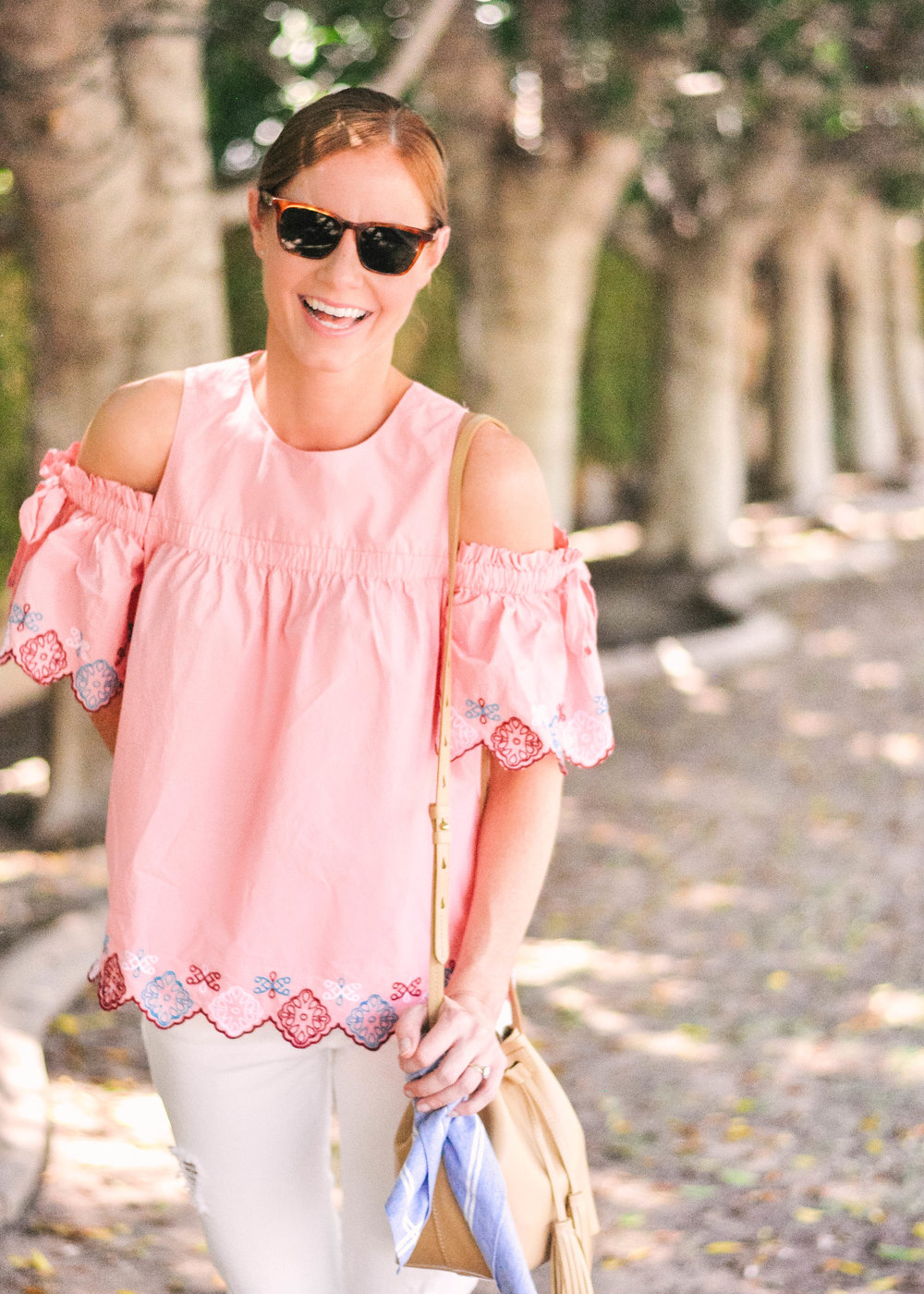 woman in Pink Loft top with open shoulders and white jeans