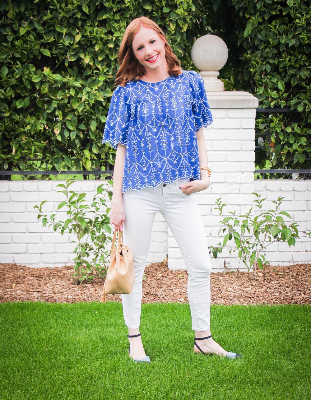 woman posing in blue top