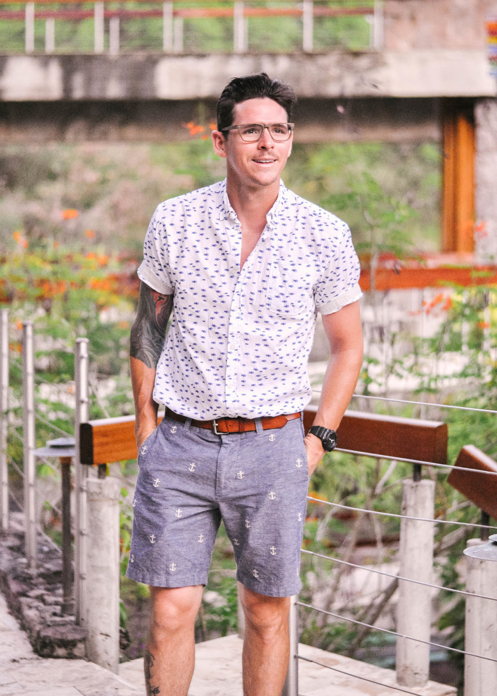 man in shorts hands in pockets