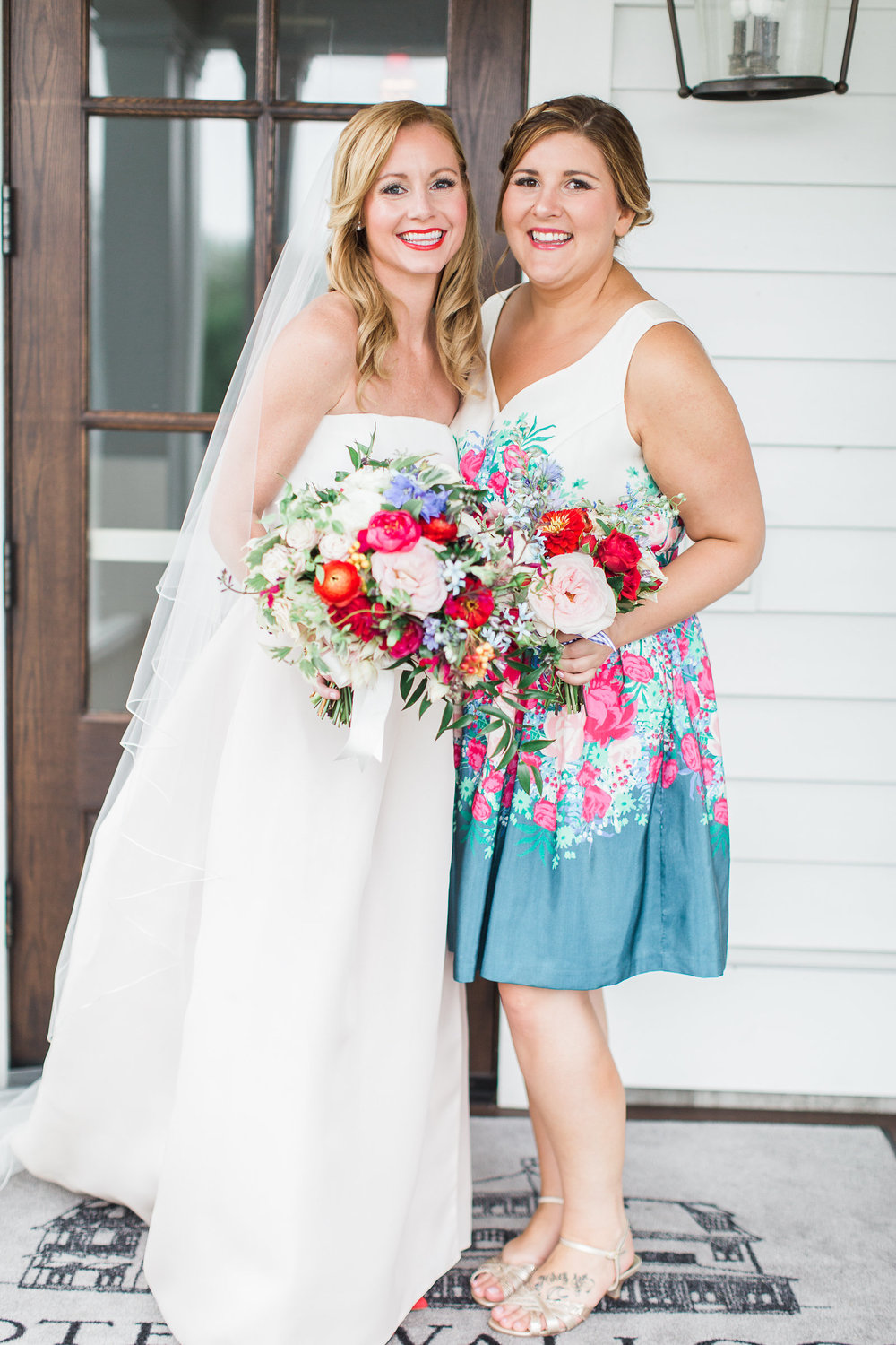 bride and friend holding flowers