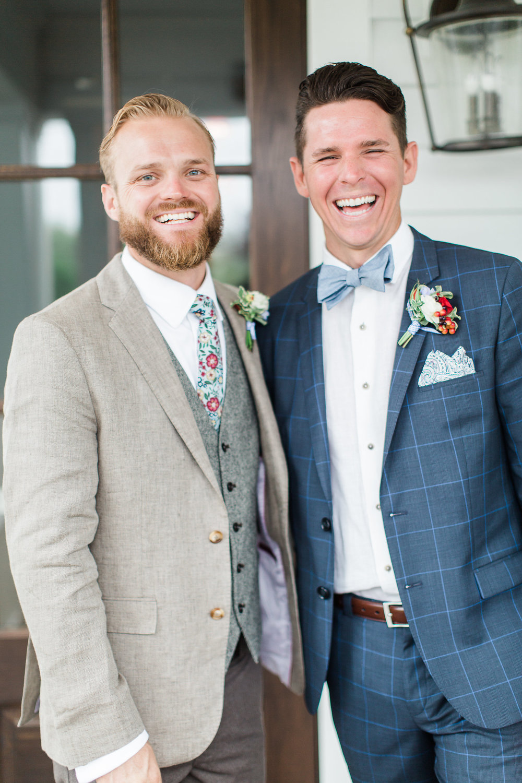 2 men in suits smiling