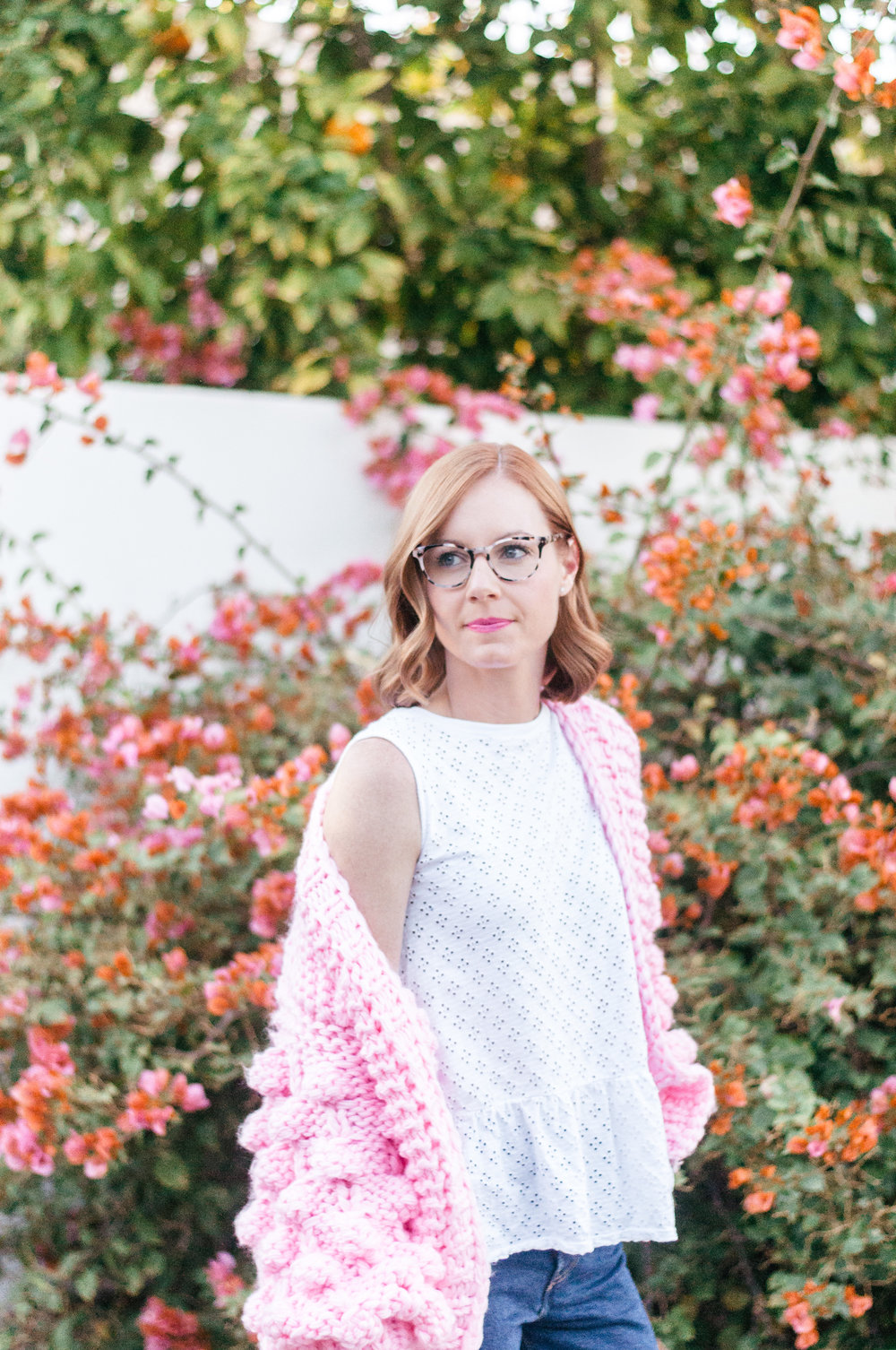 Casual Spring Outfit with White Eyelet Top, Pink Chicwish Sweater and Tortoise Glasses for Women