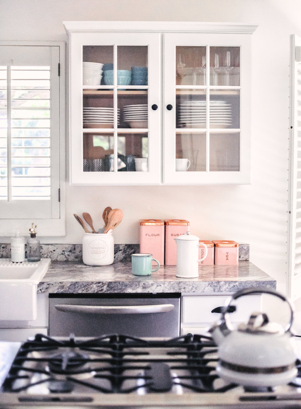 Black, Whtie and Pink Farmhouse Kitchen With Open Shelving