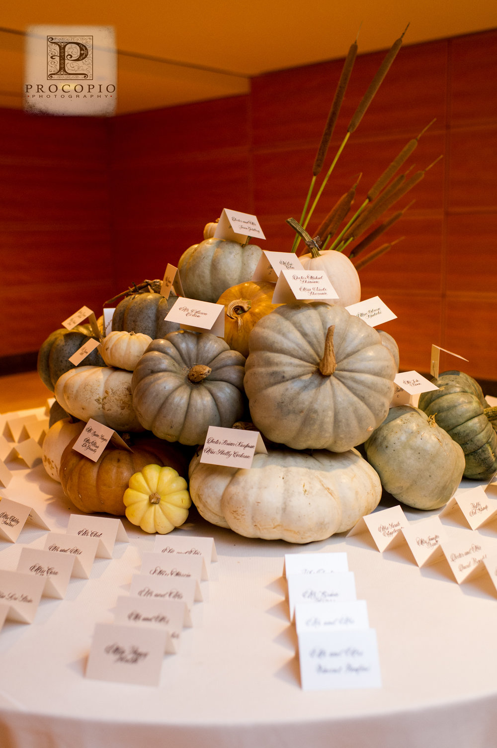 A stack of pumpkins to hold the escort cards