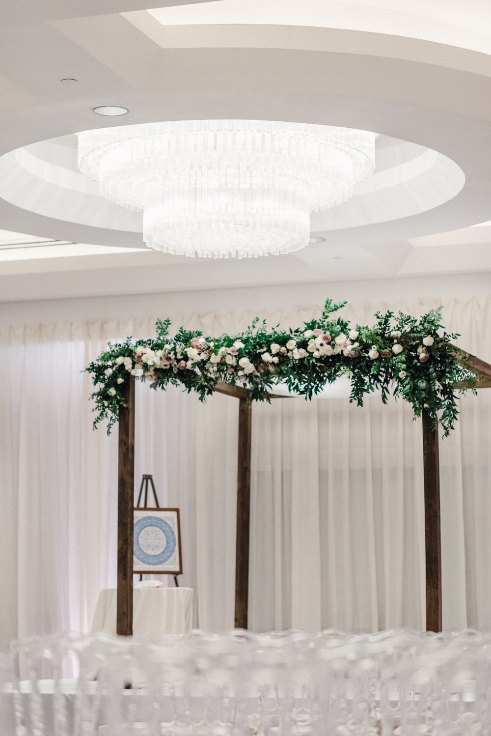 Wood chuppah with floral garland by B Floral DC
