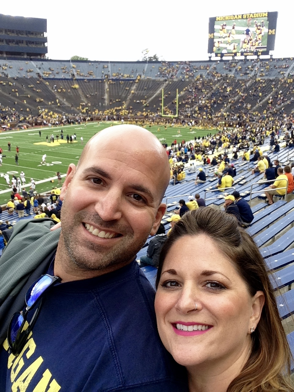 Go Blue! Cheering on the Wolverines at the Big House last September. Happy to be here with my man. Not happy about fall.