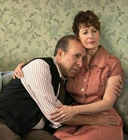 Photo Credit :Linda Loman (Paula Plum) comforts her husband, Willy Loman (Ken Baltin). (Jonathan Wiggs, The Boston Globe )
