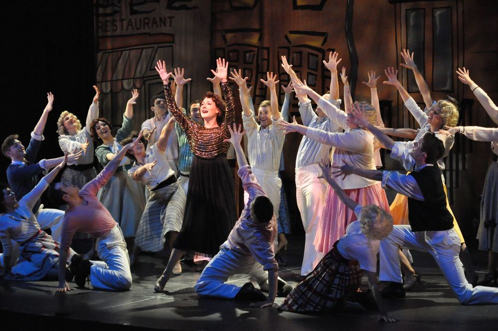 Ruth Sherwood (Katie Anne Clark) leads the cast of Reagle Music Theatre of Greater Boston's Wonderful Town to rousing success (Photo by Herb Philpott).