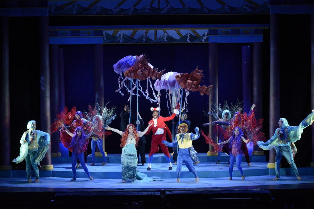 "Jay Kelley as Sebastian (center) and the Ensemble perform ""Under the Sea"" (Photo courtesy of Fiddlehead Theatre Company/Eric Antoniou)."