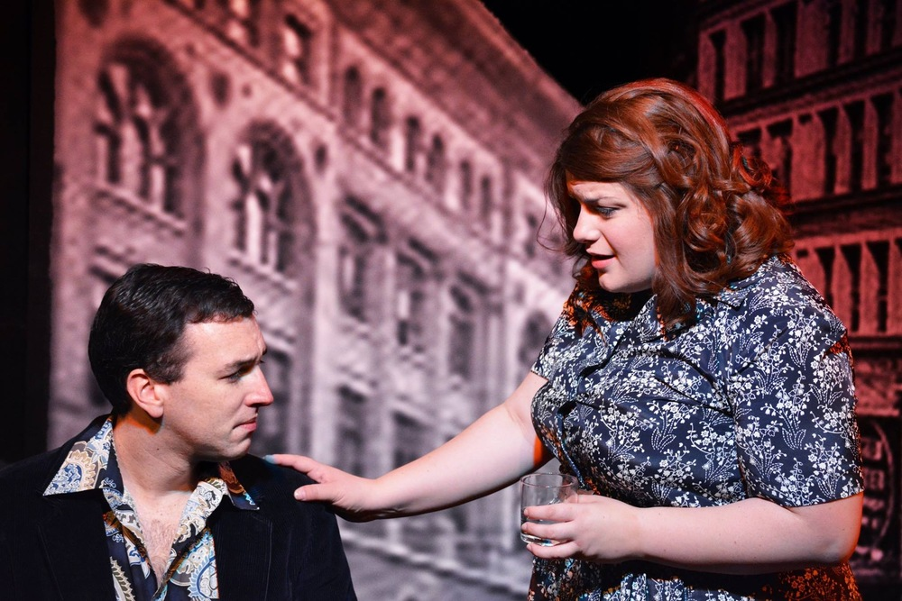 Charley Kringas (Adam Schuler) is comforted by Mary Flynn (Andrea Giangreco) in The F.U.D.G.E. Theatre Company's  Merrily We Roll Along  (Photo Credit: Matt Phillipps)