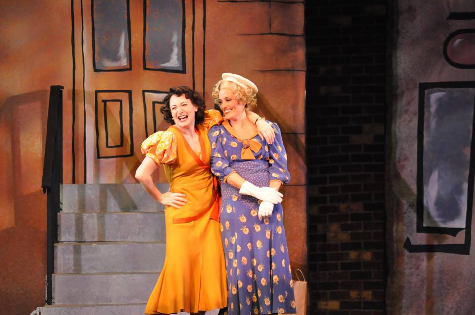 Ruth (Katie Anne Clark) and Eileen (Jennifer Ellis) share a laugh in Reagle Music Theatre of Greater Boston's  Wonderful Town  (Photo Credit:   Herb Philpott  ).