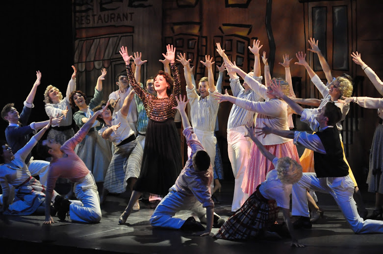 Ruth (Katie Anne Clark) raises the roof and swings in the Reagle Music Theatre of Greater Boston's  Wonderful Town , leading an Ensemble of talented singers and dancers (Photo Credit:   Herb Philpott  ).