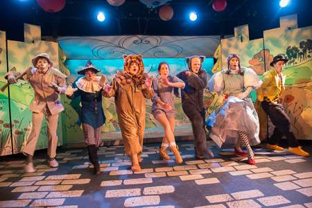 Imaginary Beasts journey to L. Frank Baum's  The Wonderful Wizard of Oz  in its Winter 2016 Panto.  (From Left): The Tinman (Michael Chodos), The Scarecrow (Amy Meyer), The Cowardly Lion (Cameron Cronin), Dorothy (Sarah Gazdowicz), Toto (William Schuller), Auntie Em (Joey Pelletier), and The Yellow Brick Road (Michael Underhill). (Photo Credit: Diane Anton).