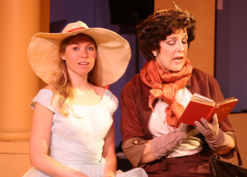 Clara Johnson (Caitlyn Oenbrink) finds beauty in Italy as her mother, Margaret Johnson (Lynn Shane), reads from her guidebook in Next Door Theater Company's The Light in the Piazza.