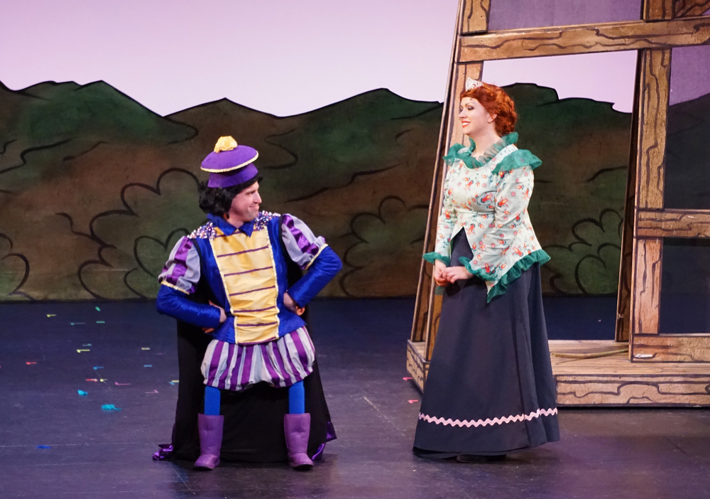 Lord Farquaad (Mark Linehan*) looks incredulously at Princess Fiona (Shonna Cirone*) in Wheelock Family Theatre's  Shrek: The Musical  (Photo Credit: Charles G. Baldwin) (* Denotes a Member of Actors' Equity Association).