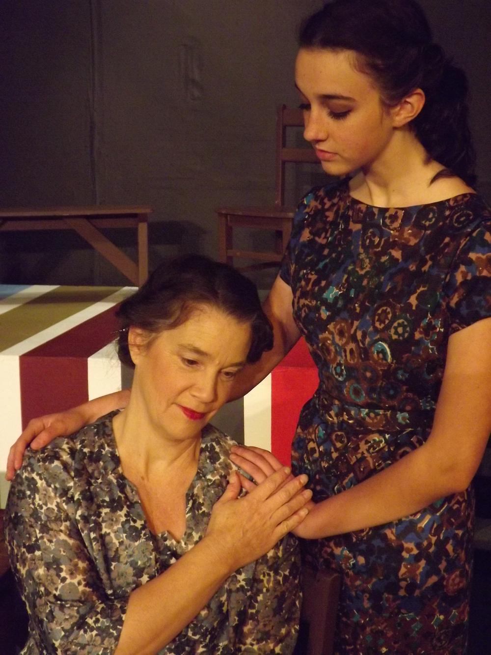Edith Frank (Karen Hoff) is consoled by her daughter, Margot Frank (Taylor Bellavia) in Theatre To Go's  The Diary of Anne Frank  (Photo Credit: Michael Molineaux).