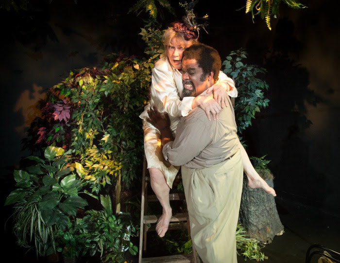 "Ballustrada (Karen MacDonald*) hangs onto Beesus (Cliff Odle) in Charlotte Meehan's ""Beesus and Bellustrada"" as part of Sleeping Weazel's ""The Birds and the Bees: A Festival of New Plays"" (Photo Credit: David Marshall) (* Denotes a Member of Actors' Equity Association)."
