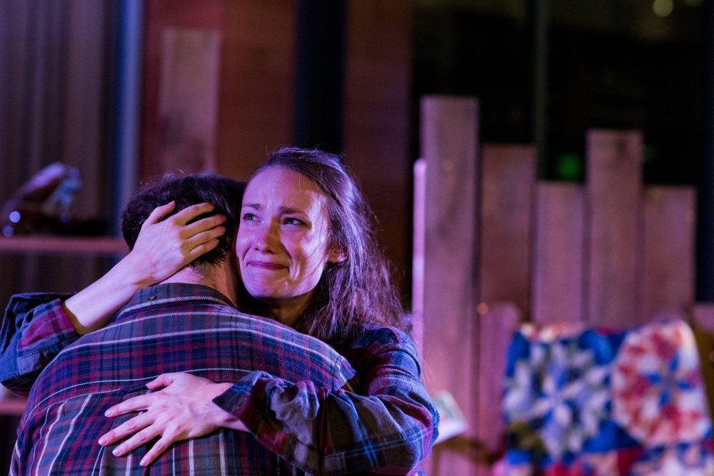 Rosannah (Laura Menzie) comforts Henry Harry (Spencer Parli Tew) in Brown Box Theatre Project's gorgeous production of Brilliant Traces (Photo Credit: Niles Scott Shots).