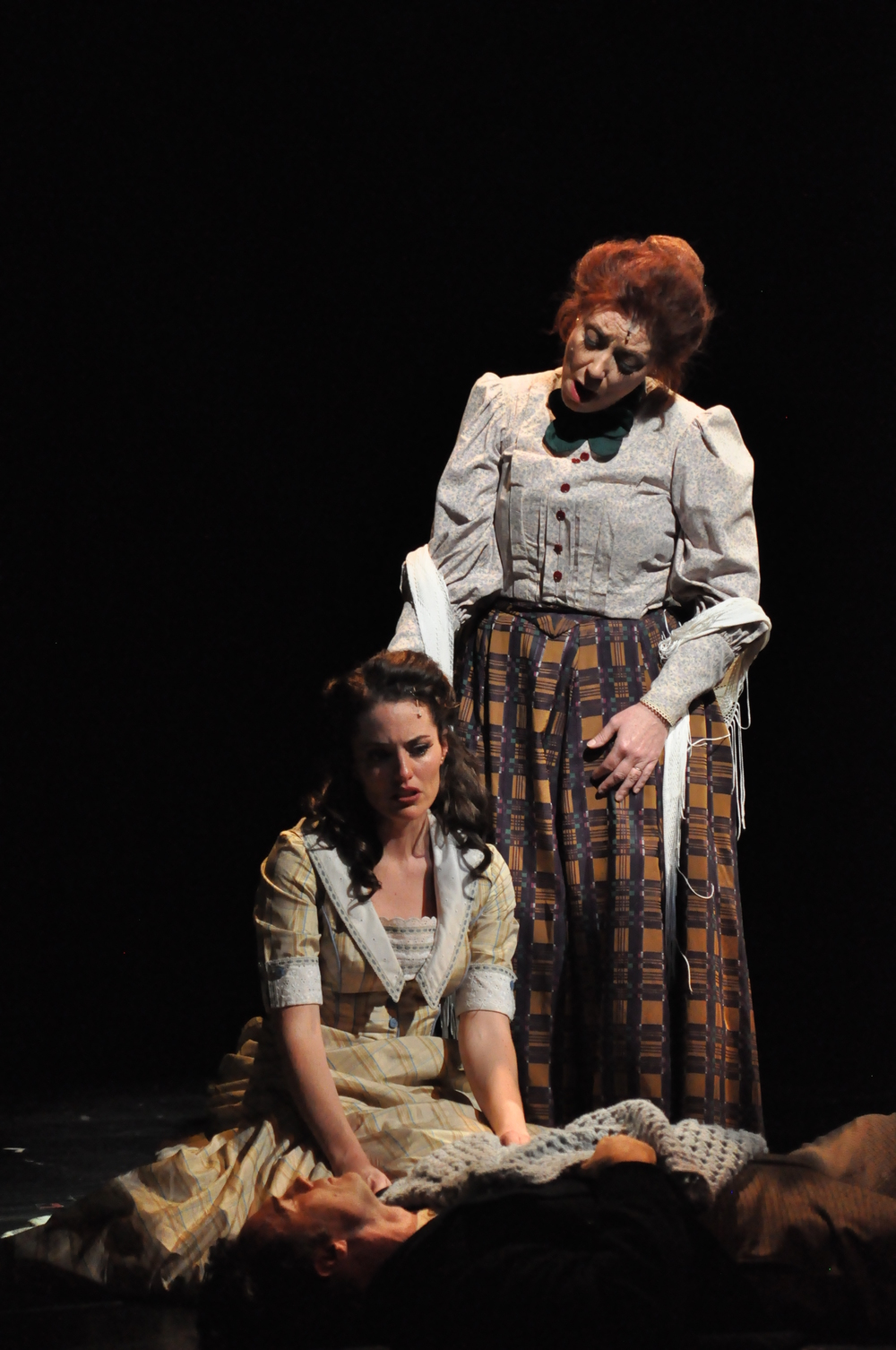 Nellie Fowler (Leigh Barrett*) sings to Julie Jordan (Jennifer Ellis*) during a key moment in Reagle Music Theatre of Greater Boston's  Carousel    (Photo Credit: Reagle Music Theatre/©Herb Philpott) (* Denotes a Member of Actors' Equity Association).