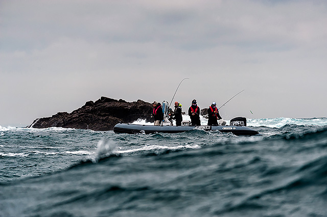 Hectic conditions for boat fishing, and of course the guys are all wearing lifejackets, but that is hardly hectic conditions for shore fishing - and how many of us here would be wearing a lifejacket when shore fishing in conditions like these?