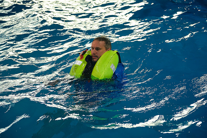 This is how an inflated lifejacket is designed to fit around you and keep your head out of the water