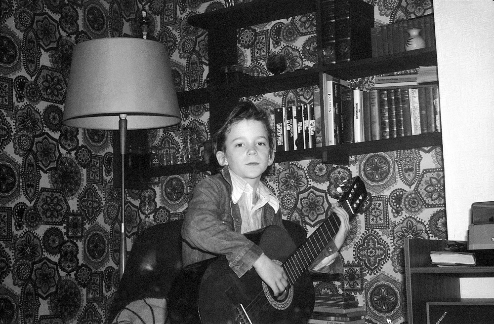 E Sheet 107 Neg 6. Neville with Guitar. Front Room. 16 Hawthorne.jpg