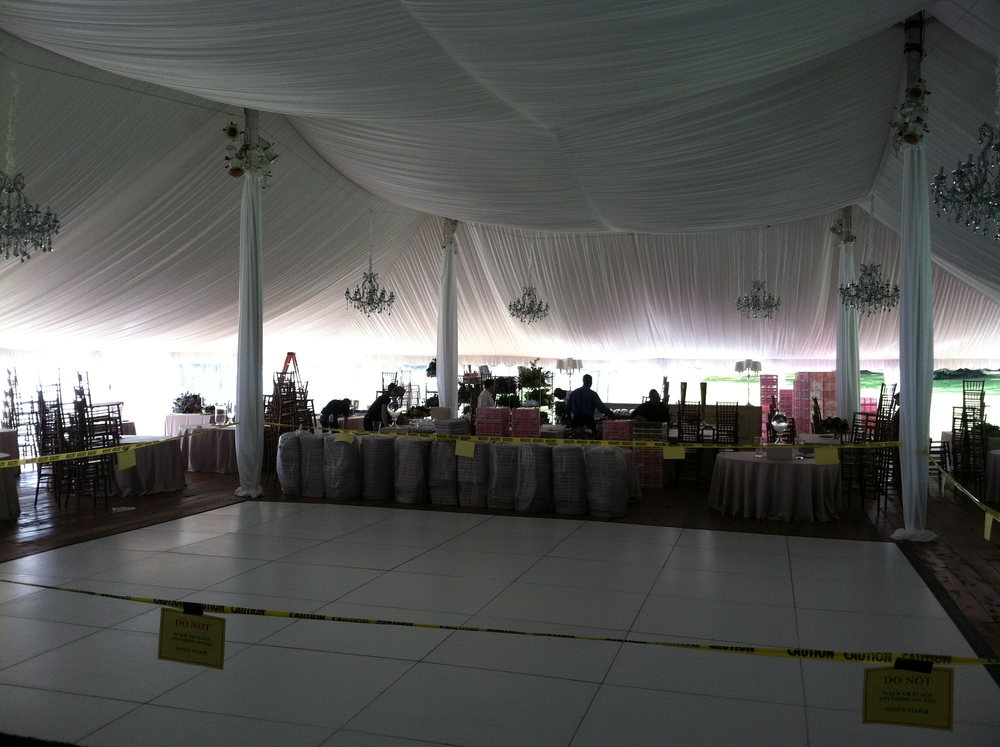 Furniture and white pleated tent liner are installed