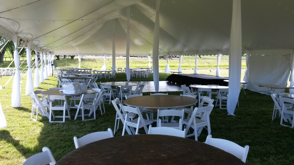 40' wide white tent with padded garden chairs, round tables