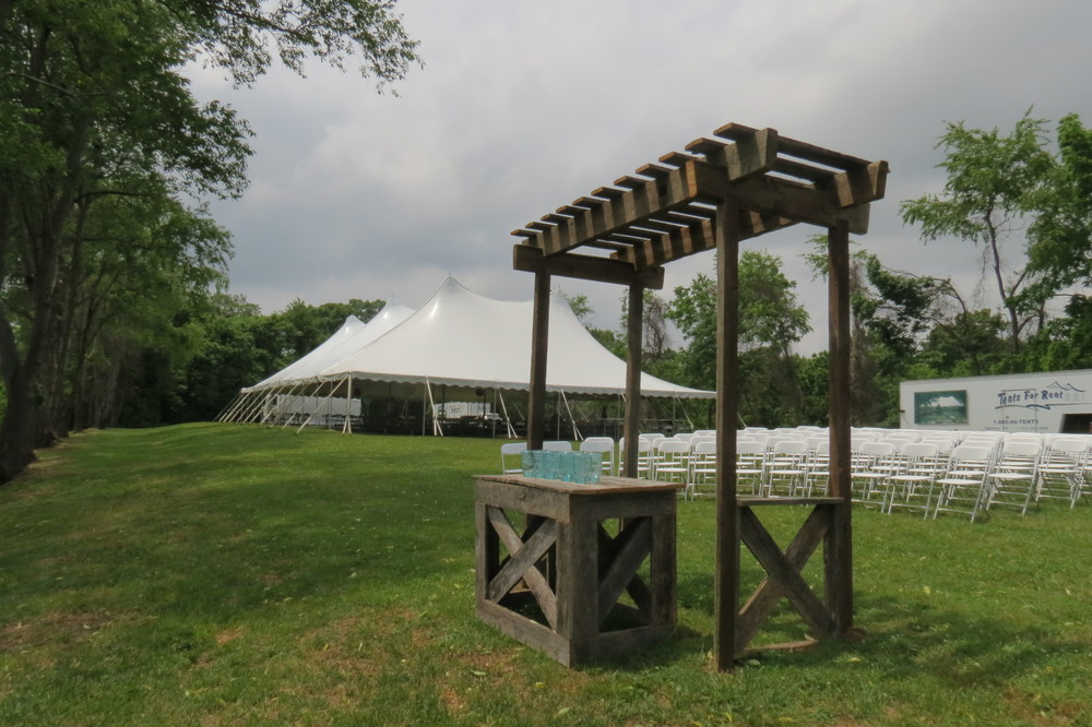 White wedding tent and white folding chairs