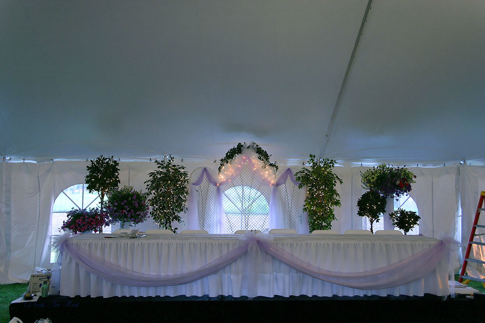 White wedding tent with cathedral window sidwall