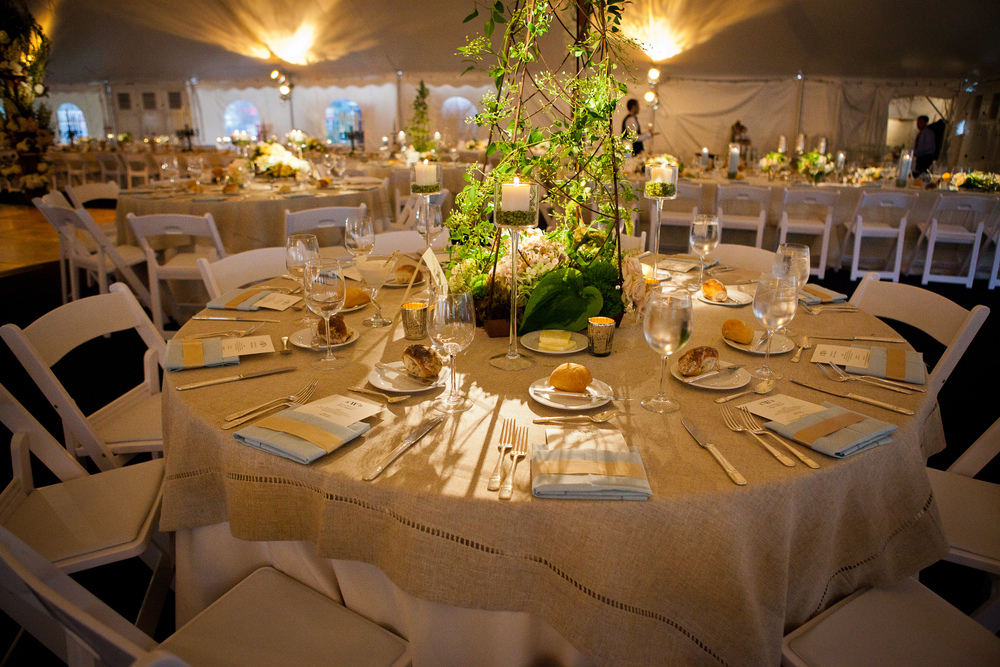 Wedding, round table and padded garden chairs