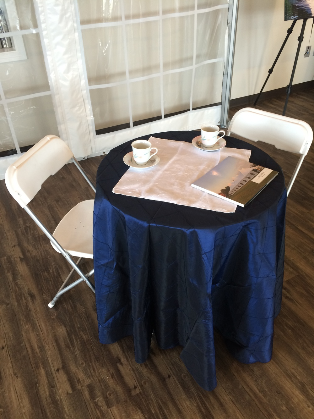 "30"" round table and white folding chairs"