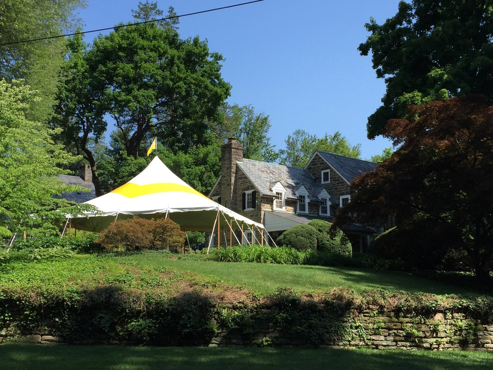 Yellow and white pole tent