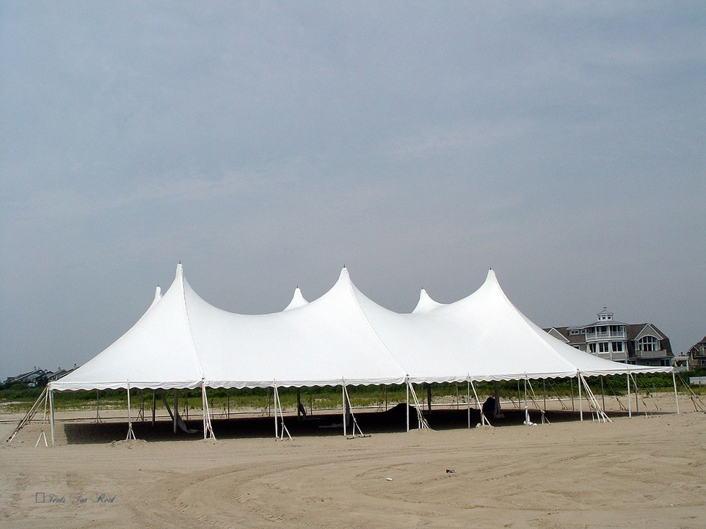 Pole tents, have tall, graceful peaks and elegant curves.