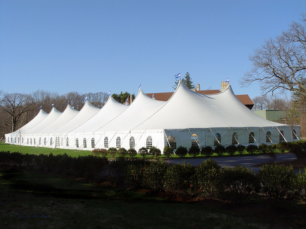 Large tent with cathedral window sidewalls
