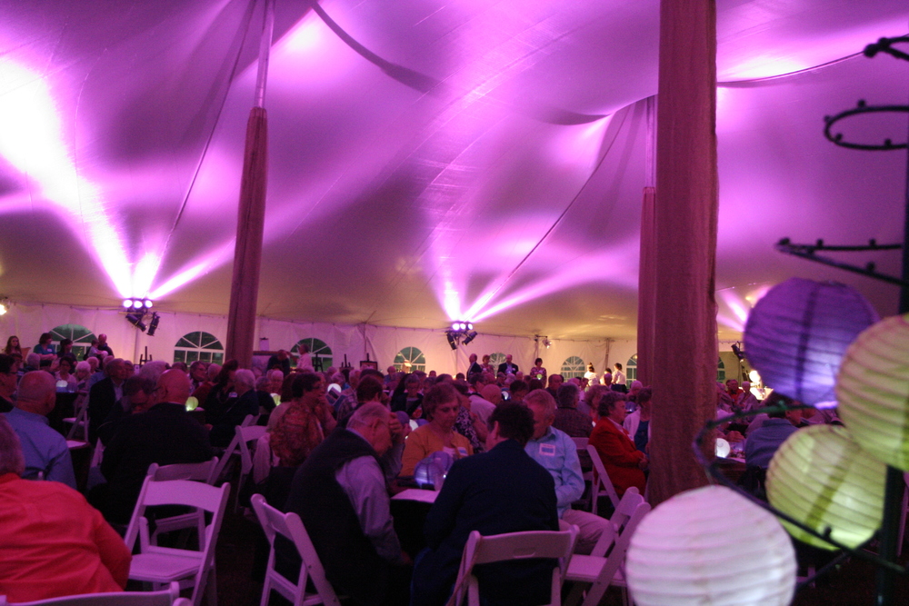 GSA contract rental tent with tables, chairs and lighting
